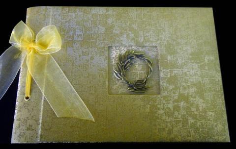 Βιβλίο Ευχών Γάμου -33 - <p>Βιβλίο ευχών γάμου από δερματίνη mosaic gold και μπρονζέ στεφανάκι.</p>...