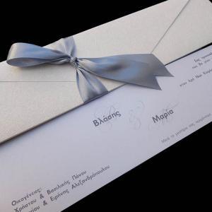 Προσκλητήρια γάμου -Γ1319 - <p>Μακρόστενος φάκελος με δερματίνη nature white και γκρι λεπτομέρειες.</p>...
