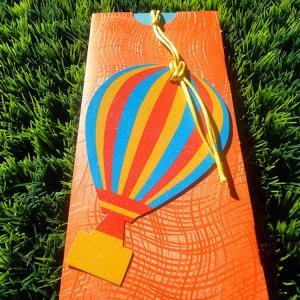 Προσκλητήρια βάπτισης -Β1351 - <p>Εντυπωσιακό προσκλητήριο με θέμα το αερόστατο, από δερματίνη orange wave και γκλίτερ αερόστετο!</p>...